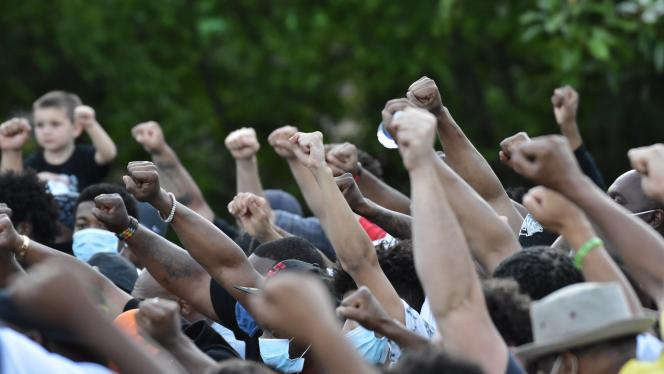 A group of protesters holding fists in the air