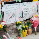 Flowers and messages are placed at a memorial for victims of the mass killing on April 24, 2018 in Toronto, Canada.