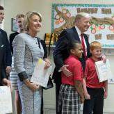 President Donald Trump and U.S. Secretary of Education Betsy DeVos poses for a photo with students of Saint Andrew Catholic School on March 3, 2017.
