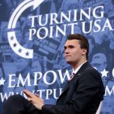 Charlie Kirk (founder of TPUSA) speaking at the 2018 Conservative Political Action Conference (CPAC) in National Harbor, Maryland.