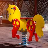 playground horse sits empty in the sun