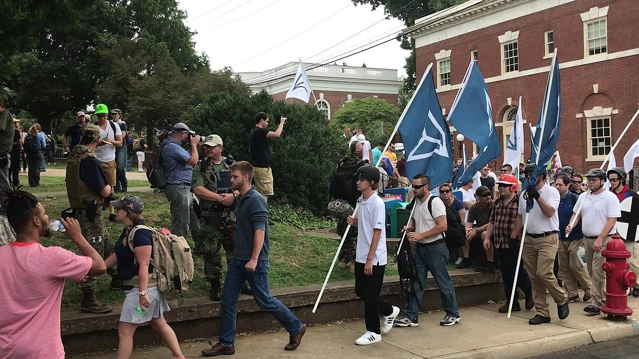 People carrying Identity Evropa flags march in Charlottesville, August 16, 2017