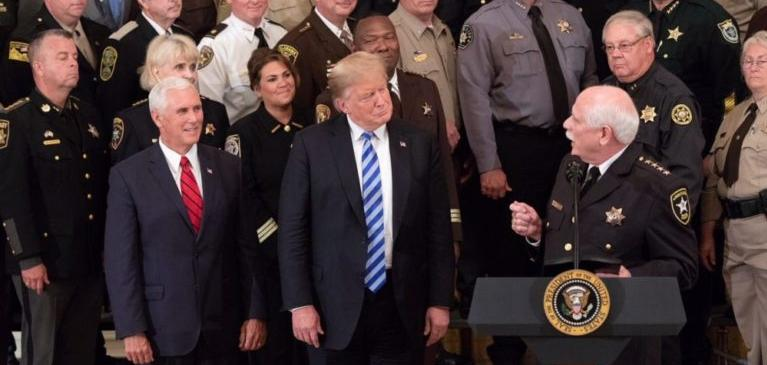 U.S President Donald Trump and Vice President Mike Pence look on as Sheriff Thomas Hodgson of Bristol County Massachusetts delivers remarks in the East Room of the White House September 5, 2018 in Washington, DC.